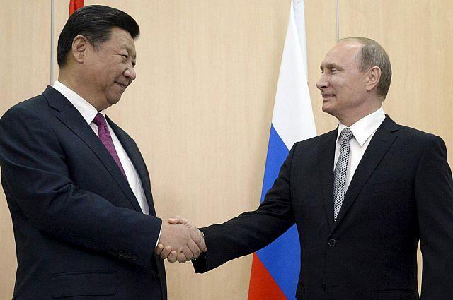 Президент РФ Владимир Путин на встрече с председателем КНР Си Цзиньпином.