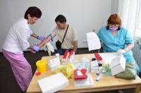 Переселенцы в Приморье проходят медицинский осмотр.