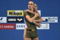 Дарина Валитова и Александр Мальцев (Россия) выступают с технической программой в финальных соревнованиях по синхронному плаванию среди смешанных дуэтов на XVI Чемпионате мира по водным видам спорта в Казани.