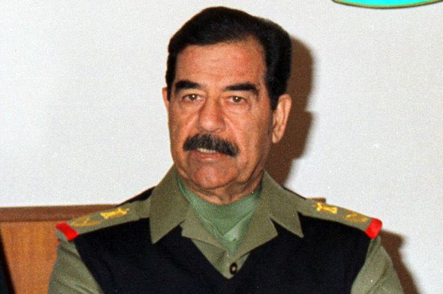 Саддам Хусейн.