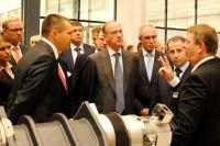 Николай Патрушев, Сергей Морозов, Михаил Бабич осматривают новый завод и его продукцию.