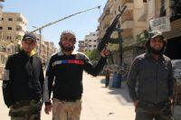 Вооружённые люди наблокпосту оппозиционной «Свободной сирийской армии» навыходе израйона Бабилля вДамаске.