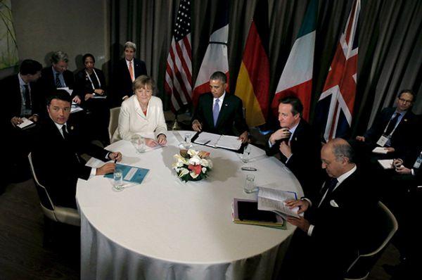Президент США Барак Обама, канцлер Германии Ангела Меркель, премьер-министр Великобритании Дэвид Кэмерон и министр иностранных дел Франции Лоран Фабиус