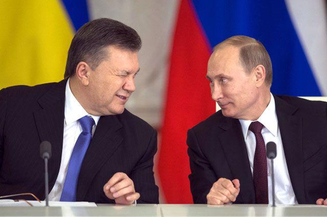 Владимир Путин и Виктор Янукович во время церемонии подписания совместных документов по итогам шестого заседания Российско-Украинской межгосударственной комиссии в Кремле.