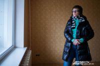 Светлана в своей пустой квартире.