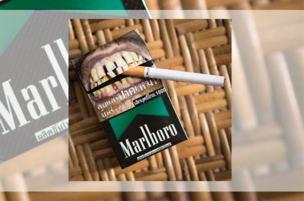 Пугающие картинки можно увидеть на пачках сигарет не только в России. Подобный способ информирования о вреде курения практикуется в, например, Австралии, Канаде, Бразилии и Тайланде (на фото).