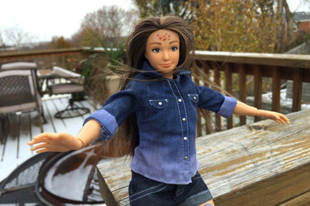 В декабре 2014 году дизайнер Николай Лэм создал свой вариант куклы – Лэммили, которая выглядит как обычная девушка. У нее средний рост, несколько лишних килограммов и «несовершенства» на лице. Кроме того, в комплекте к кукле прилагаются дополнительно наклейки-прыщи, наклейки-синяки, наклейки-растяжки, наклейки-татуировки и наклейки-шрамы.