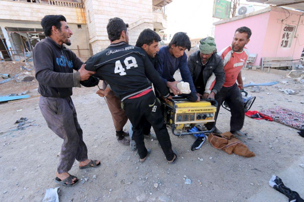 Драка на улице за украденный электрогенератор, Аль-Шадади, Хасака.