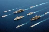 Авианосцы USS John C. Stennis (CVN-74), Шарль Де Голль, HMS Ocean (L12) и USS John F. Kennedy (CV-67) в сопровождении эскортных судов, 2002 год.