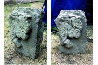 Фрагмент каменного архитектурного блока с барельефным изображением сцены терзания льва грифоном.