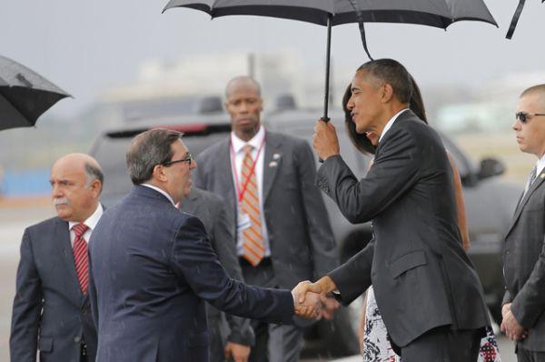 Барак Обама и министр иностранных дел Кубы Бруно Родригес Парилья.
