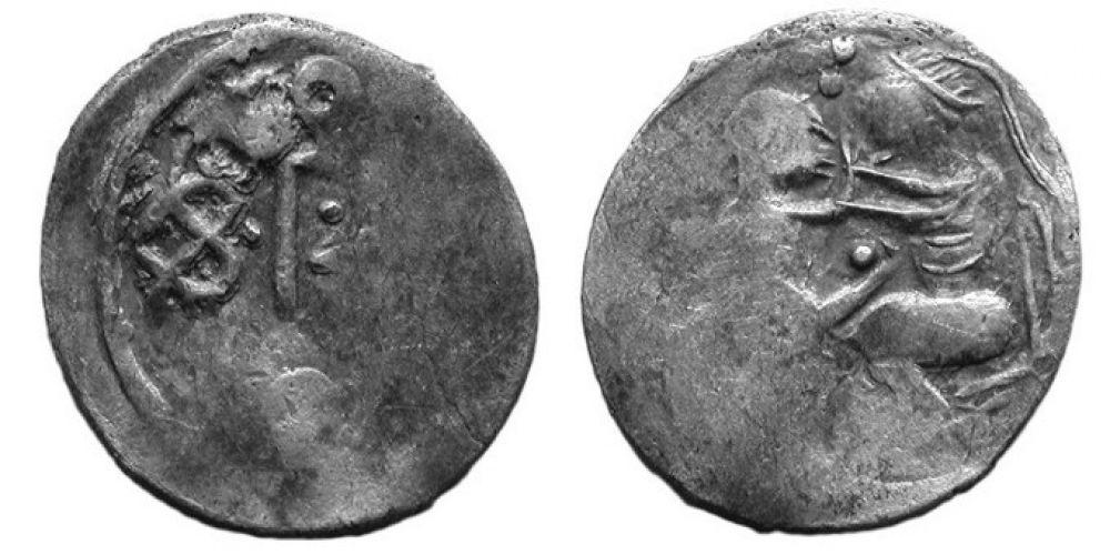 На этой монете изображена женщина с ребёнком. Некоторые исследователи полагают, что это Дева Мария с младенцем Христом.