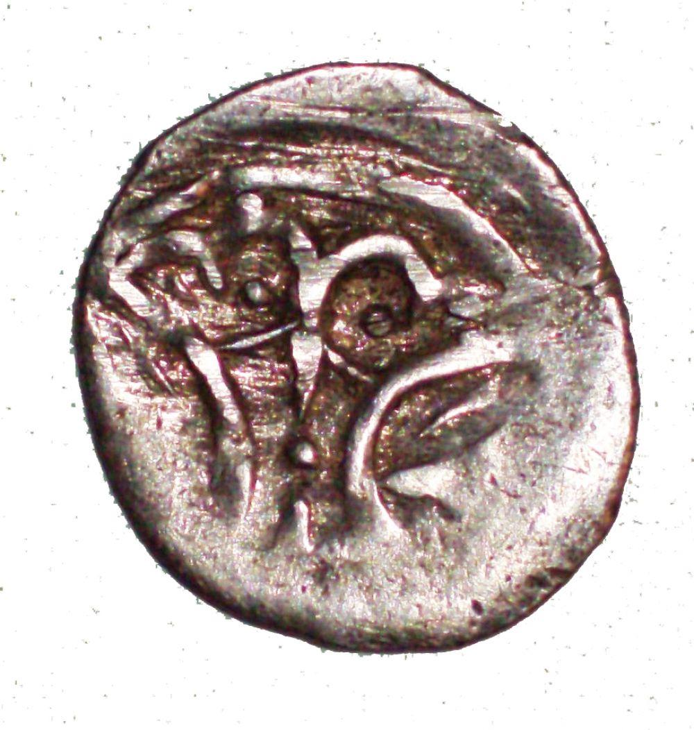 Монета с изображением двуглавого орла. Символика ближневосточного региона.