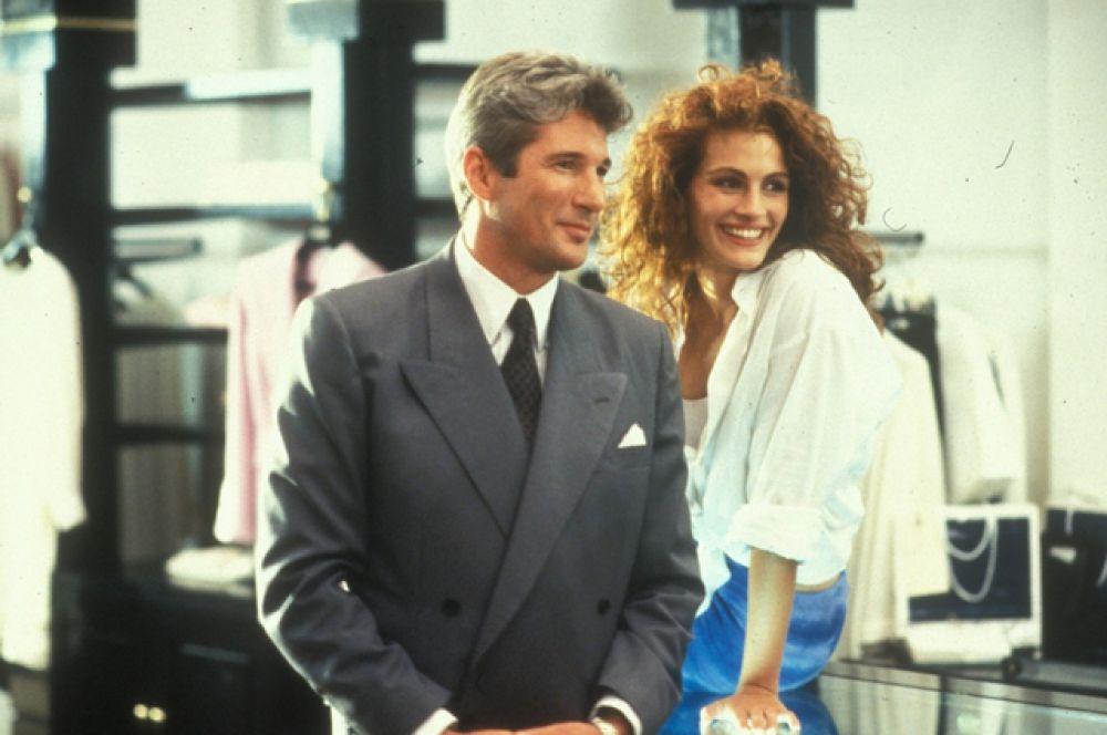 «Красотка» (1990). Культовая история любви финансового магната Эдварда Льюиса (Ричард Гир) и девушки по вызову Вивьен (Джулия Робертс).