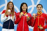 Слева-направо: россиянка Юлия Ефимова (серебро), японка Риэ Кането (золото) и китаянка Ши Цзинлинь (бронза).
