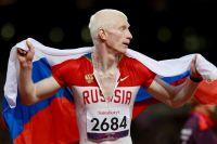 Российский спортсмен Федор Триколич, завоевавший серебрянную медаль в финале бега 200 метров в категории Т12 по легкой атлетике на ХIV летних Паралимпийских играх в Лондоне, после забега, 2012 год.