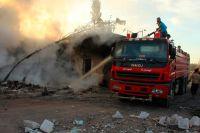 Последствия авианалета под Алеппо.