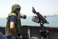 Военный ВМС США на ракетном эсминце «Мэйсон».
