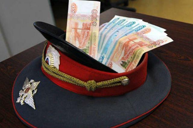 ВРостове четверо полицейских подбросили преподавателю университета взятку