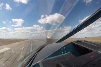 Бомбардировщик Су-34 ВКС РФ во время взлета с авиабазы Хамадан.