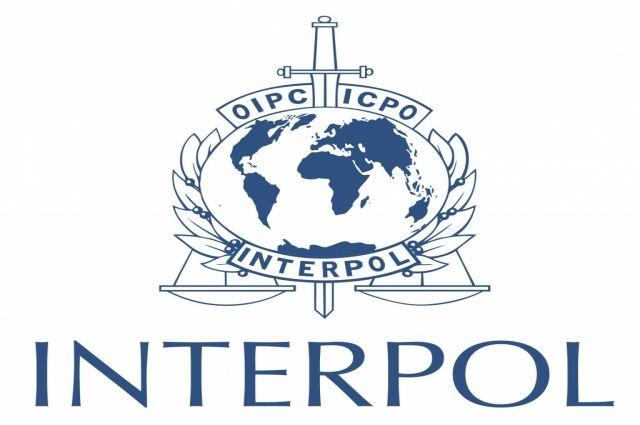 Эмблема Интерпола