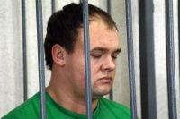 На снимке один из осужденных убийц.