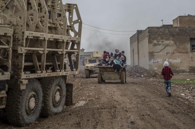 Как минимум покрайней мере 15 человек погибли при 2-х взрывах вМосуле