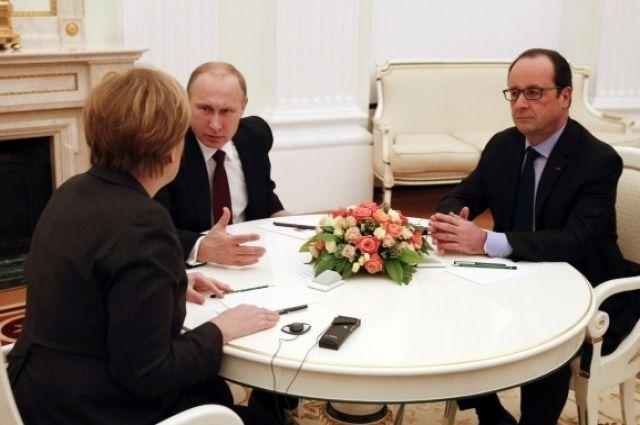 Путин обсудил сМеркель иОлландом Минские договоренности