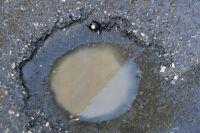 На момент ДТП на дороге имелись выбоины, размером  до одного метра  при глубине до 10 см.