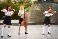 Струнное трио «Силенциум».  Наталья Григорьева на фото в центре.