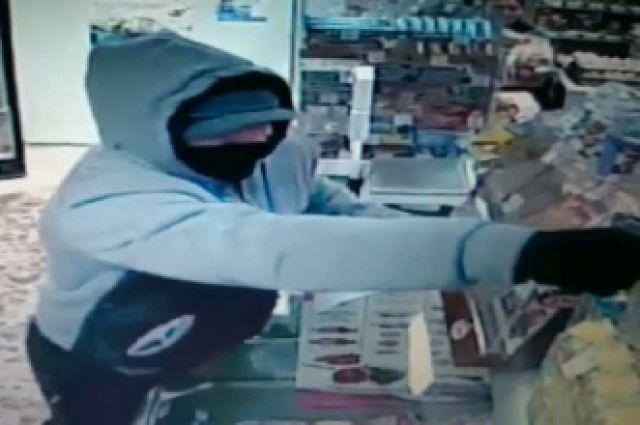 Грабителя, который накануне потерпел неудачу вломбарде наулице Бардина, разыскивает милиция