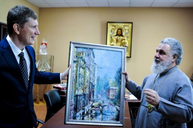 Максим Решетников вручил владыке картину известного пермского художника Владислава Дёгтева «Улица Монастырская».