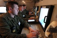 Кибероперации, где главное оружие - компьютер, по мощи не уступают обычным, с применением ракет, танков и самолётов.