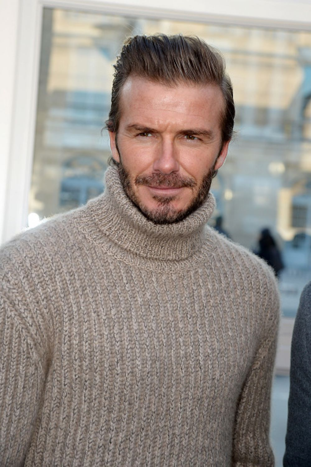 Футболист Дэвид Бекхэм на показе Louis Vuitton