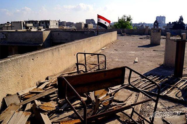 Изпригорода сирийского Хомса выведены 400 боевиков ссемьями