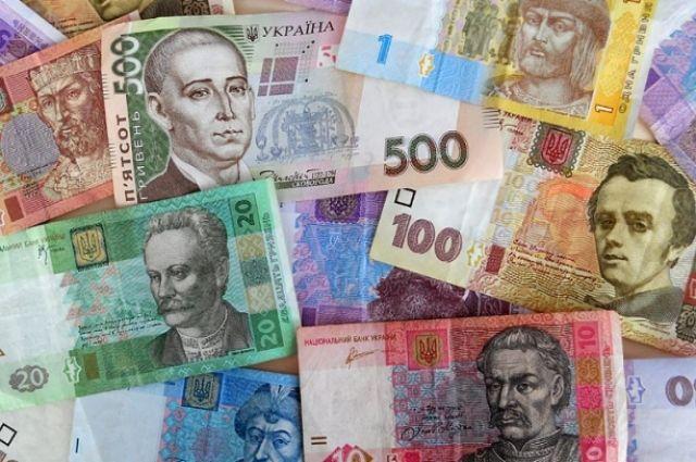 Кабмин прогнозирует падение гривны из-за блокады Донбасса