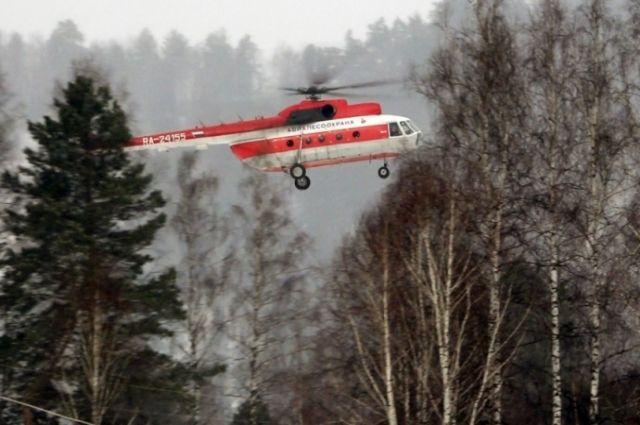 Поиски вертолета были приостановлены из-за погоды.
