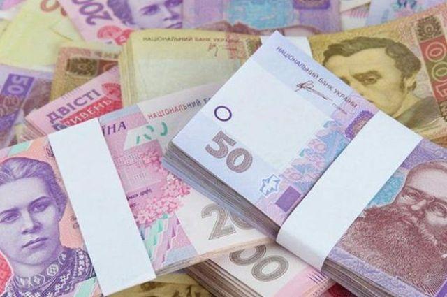 Согласно опросу, среднее значение курса ожидается на уровне 29,44 гривны/доллар