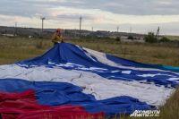 Цвета российского флага повторят воздушные шары.