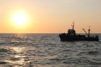 Спасатели ищут в Куршском заливе двух пропавших рыбаков.