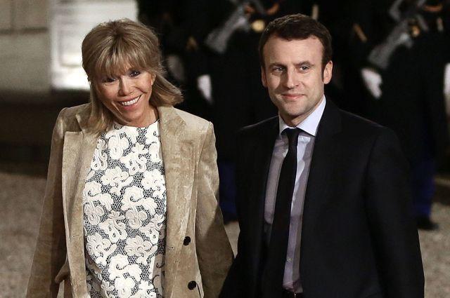 Эммануэль Макрон с супругой.