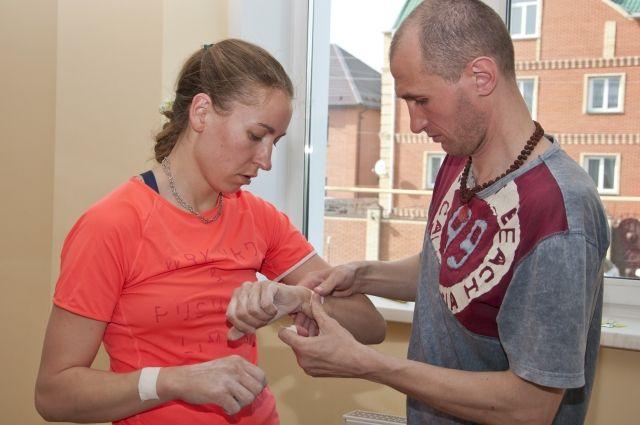 Ольгу Ярёменко тренирует Александр Шанин.