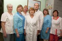 Персонал клиники и его руководитель Татьяна Глинская (в центре).