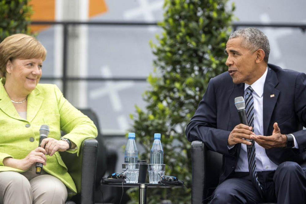 25 мая 2017 года. Канцлер ФРГ Ангела Меркель и экс-президент США Барак Обама приняли участие в дискуссии в Берлине, где в присутствии горожан обсудили миграционный кризис, борьбу с терроризмом и разоружение.