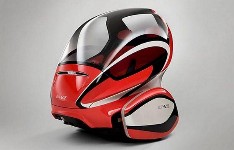 Chevrolet EN-V. Эта машинка рассчитана на водителя и 1 пассажира, укомплектована ламбо-дверьми, камерами, сенсорами и ПО, позволяющим общаться с другими машинами на дороге.