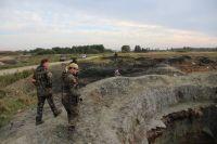 Под Зеленоградском засыпали разрытые «черными копателями» котлованы.