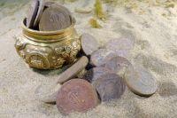 Торговля предметами археологии незаконна, но это не останавливает желающих нажиться на артефактах. На фото - древности, найденные при раскопках в районе Байкала