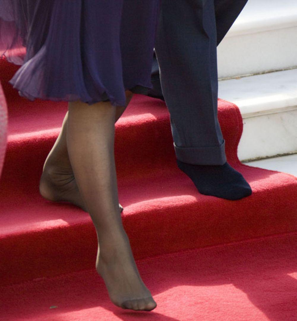 2009 год. Чарльз, принц Уэльский, и Камилла, герцогиня Корнуольская, во время празднования индуистского фестиваля Холи.