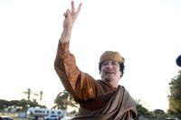 Муаммар Каддафи.
