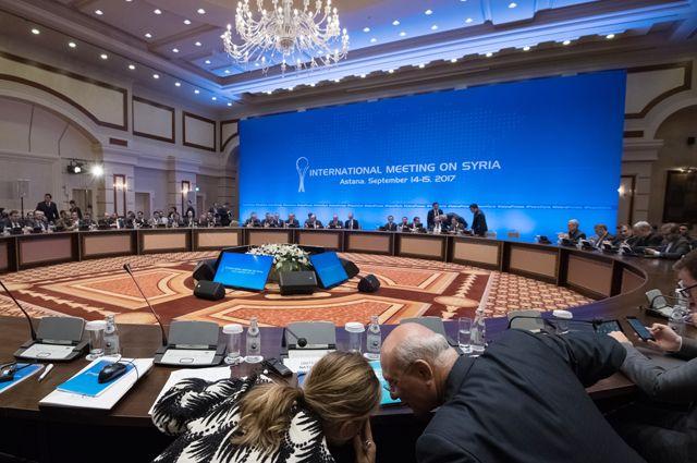 Участники заседания совместной оперативной группы по сирийскому урегулированию на международной встрече в Астане.